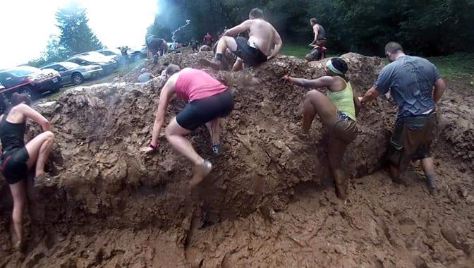 Warrior Dash mud climbers