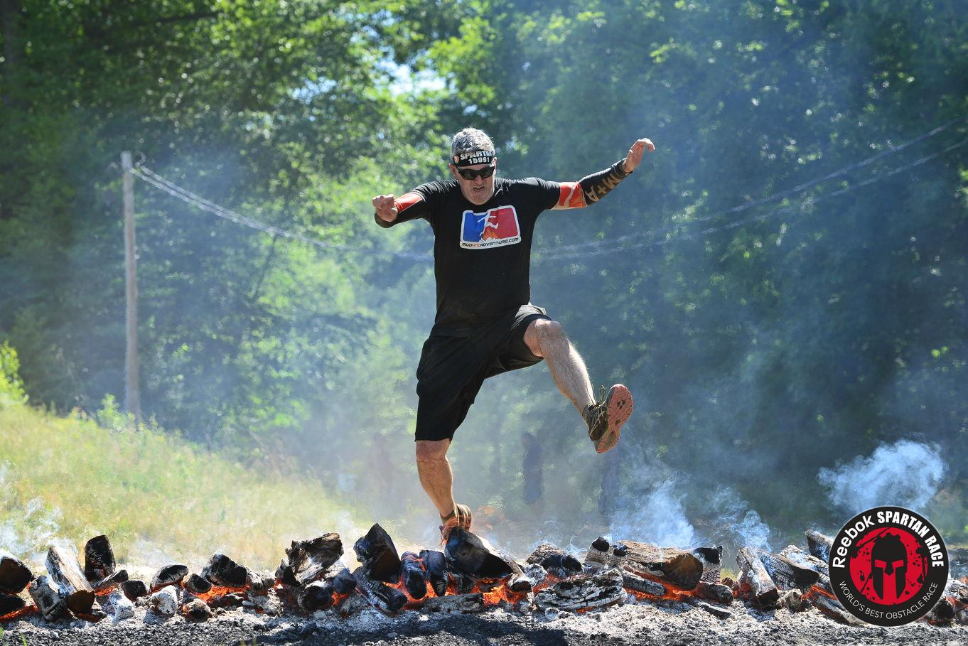 Christopher jumps over Spartan fire awkwardly
